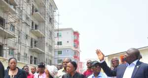 Lagos State Governor, Mr. Akinwunmi Ambode (left); pointing at place of interest during his inspection of the site of the collapsed building in Lekki Gardens at Ikusenla Road, Ikate Elegushi, Lagos, on Tuesday, March 15, 2016. With him is Commissioner for Physical Planning & Urban Development, Engr. Wasiu Anifowose