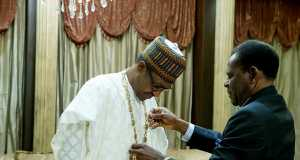 Buhari being decorated by Equatorial Guinea president