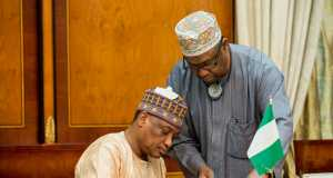 Nigeria's Minister of Defence signing the joint security patrol