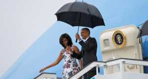 U.S. President Barack Obama and his wife Michelle exit Air Force One as they arrive at Havana's international airport for a three-day trip, in Havana March 20, 2016.
