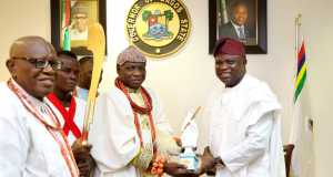 Lagos State Governor, Mr. Akinwunmi Ambode (right), presenting an Eyo statue to Olu of Warri, King Godfrey Ikenwoli Emiko, Ogiame Ikenwoli I, during a courtesy visit by the Olu of Warri, at the Lagos House, Ikeja on Monday,