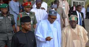 Osinbajo, Buhari and Tinubu at the Bolat Tinubu Colloqium in Abuja