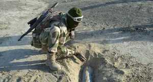 Nigerian Army personnel removing land mine buried by terrorists