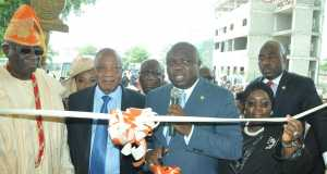 Lagos State Governor, Akinwunmi Ambode (middle), cutting the tape to commission the Lagos State University (LASU) Radio during the 20th convocation ceremony at the Institution's Campus, Ojo, Lagos on Thursday, May 26, 2016. With him are Deputy Governor, Dr. (Mrs.) Oluranti Adebule (2nd right); Special Adviser to the Governor on Education, Mr. Obafela Bank-Olemoh (right); Asoju Oba of Lagos, Chief Adebutu kessington (2nd left) and Oba of Lagos, Oba Rilwan Akiolu I (left).