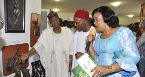 Minister of Information and Culture, Alhaji Lai Mohammed, Minister of Science and Technology Dr. Ogbonnaya Onu and the Director General of the National Council for Arts and Culture, Mrs. Keshi Dayo at an arts exhibition in Abuja on Saturday.