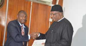 Air Commodore Yusuf Anas rtd make a presentation to Minister of Interior Lt Gen Dambazau in Abuja