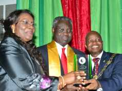 Outgoing GMD/CEO, UBA Plc and Valedictory Lecture Speaker, Mr. Phillips Oduoza (middle), wife Jumai and President, Chartered Institute of Bankers of Nigeria(CIBN), Professor Segun Ajibola(Right) at the 4th Valedictory Lecture in honour of Phillips Oduoza, organised by CIBN in Lagos