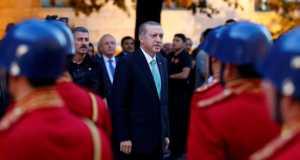 Turkish President Tayyip Erdogan reviews a guard of honour as he arrives to the Turkish Parliament in Ankara, Turkey, July 22, 2016. REUTERS/UMIT BEKTAS