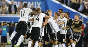 Jubilant Germany players celebrating victory over Italy