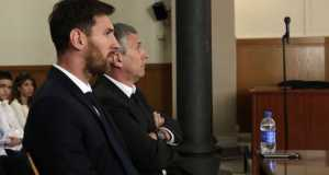 Lionel Messi, left, in court with his father in June