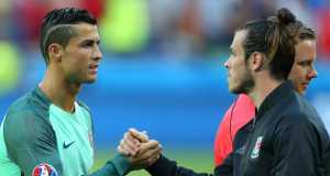 Cristiano Ronaldo of Portugal shakes hands with Gareth Bale of Wales