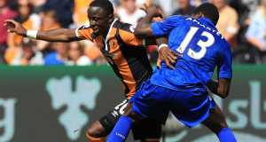 Hull City's Uruguayan striker Abel Hernandez (L) and Leicester City's English defender Wes Morgan (R) go up for a header during the English Premier League football match between Hull City and Leicester City at the KCOM Stadium in Kingston upon Hull, north east England on August 13,