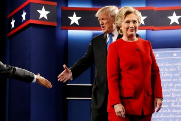 Trump and Clinton greet one another as they take the stage for their first debate at Hofstra University in Hempstead, New York, U.S.