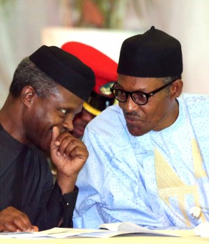 Vice President Yemi Osinbajo and President Muhammadu Buhari discussing