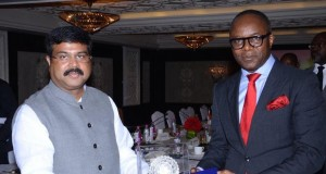 Dr. Emmanuel Ibe Kachikwu receiving a souvenir from the Indian Minister of State in charge for Petroleum & Natural Gas, Shri Dharmendra Pradhan