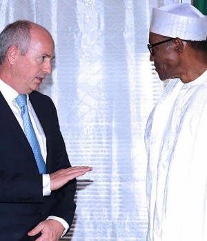 Andrew Brown, Director, Global Upstream of Shell Oil Company with President Buhari