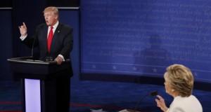 Trump speaks as Clinton listens during their third and final 2016 presidential campaign debate at UNLV in Las Vega