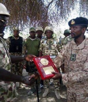 Col. Muhammed Abu-Ali, receiving an award from Chief of Army Staff, Brig. Gen. Yusuf Burutai