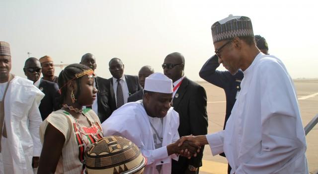 Gov. Tambuwal receiving President Buhari on arrival in Sokoto