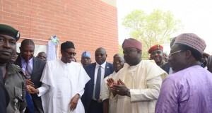 Acting Vice Chancellor, Edo University, Prof. Emmanuel Aluyor; President Muhammadu Buhari; Edo State Governor, Comrade Adams Oshiomhole and Lagos State Governor, Mr. Akinwunmi Ambode during the unveiling of the plaque to commission the Muhammadu Buhari Administrative Complex at the Edo University, Iyamho, Edo State, on Tuesday,