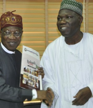 Minister of Information and Culture, Alhaji Lai Mohammed (left) receiving the letter of invitation to Ijakadi Festival in Offa, Kwara State, from the President of the Offa Descendants Union, Alhaji Najeem Usman Yasin, in Abuja