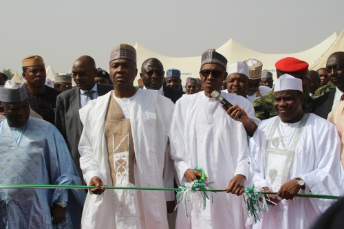 Senate President Bukola Saraki, President Buhari and Gov. Tambuwal at the commissioning of the 500 Housing units