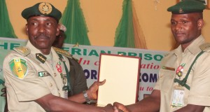 Ja'afaru Ahmed, NPS boss presenting certificate