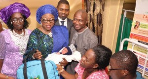Ambode's wife, Bolanle with Dr. Jide Idris, Health Commissioner presenting gift items