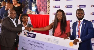 Gov. Ambode handing over cheque to ETF beneficiaries