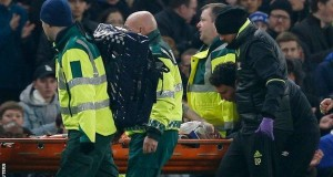 Mason being stretchered out
