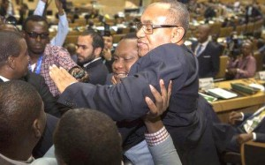 Ahmad carried by supporters