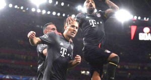 Bayern players celebrating Arsenal's crashing