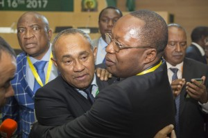 Ahmad being congratulated after defeating Hayatou