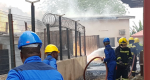 Firemen trying to put out NAFDAC warehouse inferno