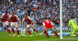 Arsenal knock out Man City