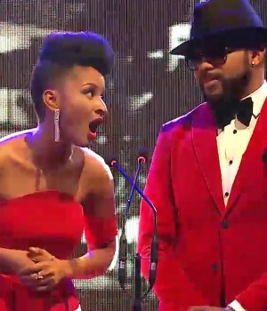 Banky W and Adesua Etomi on stage