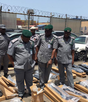 Customs officers inspecting the seized items