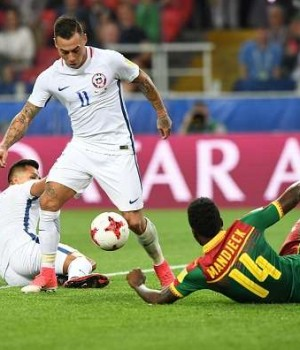 Chilean player rounded up a Cameroonian plater in FIFA Confed Cup tie in Russia