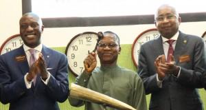 Outgoing DMO boss, Abraham Nwankwo beats the closing gong at the NSE
