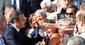 French President Emmanuel Macron leaves city hall in Le Touquet