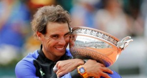 Nadal cuddles his trophy