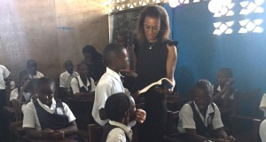 Atta, reading to pupils of C. William Brumskine elementary school, Monrovia, during a visit to the school as part of UBA foundations Read Africa, Initiative