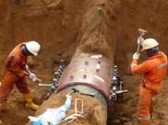 Engineers repairing one of the vandalised pipelines