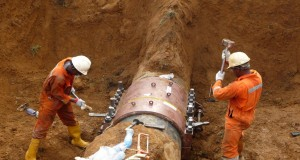 Engineers repairing one of the vandalised pipelines