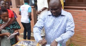 Ambode casting his votes
