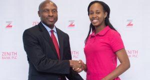 Peter Amangbo, MD, Zenith Bank, presenting gift to Katherine Eta, winner of global Microsoft Championship