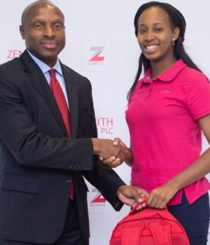 Peter Amangbo, MD, Zenith Bank, presenting gift to Katherine Eta, winner of global Microsoft Championship
