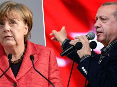 Turkish President, R, squares up against German's Chancellor Merkel