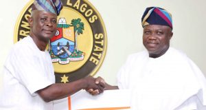 Ambode (right), being presented with a souvenir by President, Lagos State Council of Tradesmen and Artisans (LASCOTA), Alhaji Nurudeen Buhari