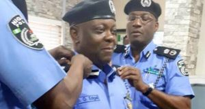 Edgal-Imohimi, new Lagos CP being decorated by his predecessor, Fatai Owoseni